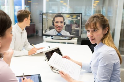 Business meeting in office, group Of Businesspeople In video con